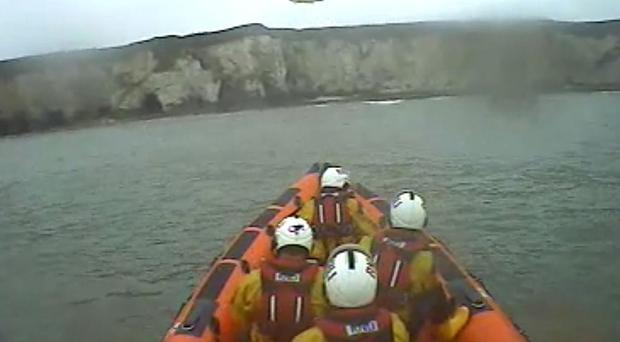 The RNLI responding after a helicopter crashed into the sea at Flamborough, killing two men (RNLI/PA)