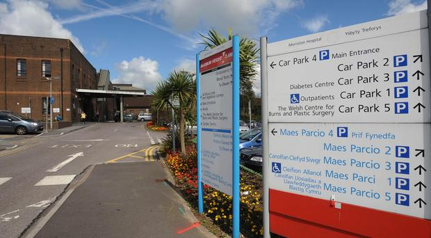 A patient died in an ambulance queuing outside Morriston Hospital in Swansea