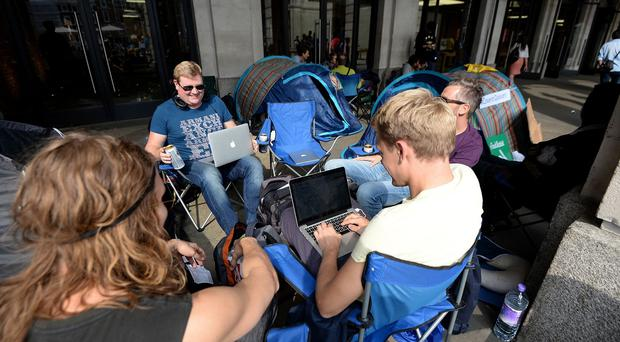 Fans camp outside the Apple Store in Covent Garden, London