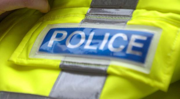 Officers are questioning a 36-year-old woman after the care home death