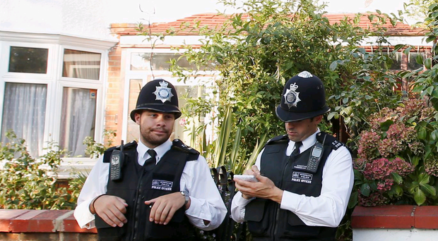 Police outside the property at Boston Road
