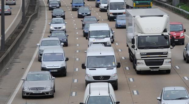 The people were seen running from the lorry on the M25