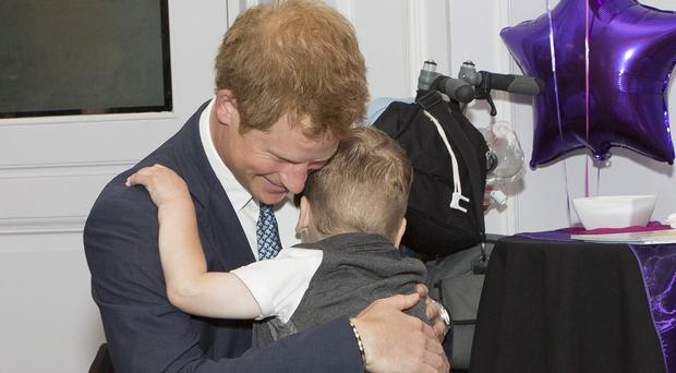 Prince Harry meets Carson Hartley who suffers from lung disease, heart defect, Spina bifida and brittle bone disease