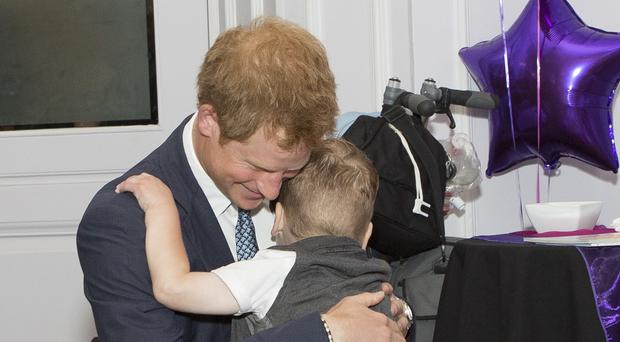 Prince Harry meets Carson Hartley, four, one of the winners at the WellChild Awards ceremony in London.