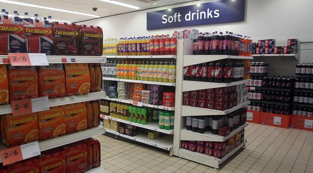Even people of a normal weight should be urged to avoid fizzy drinks, sports drinks, squashes and other hot or cold drinks that contain added sugar, Nice said