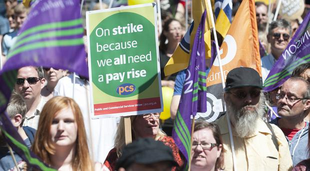 Public sector workers march through Nottingham city centre in a one-day walkout
