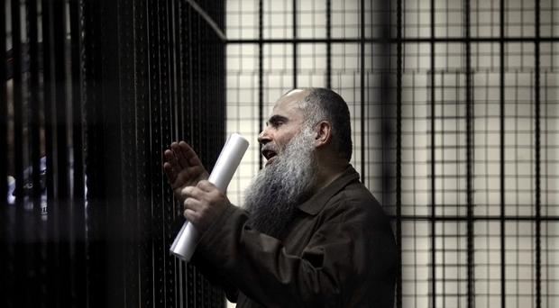 Abu Qatada speaks to the press prior to his verdict at the Jordanian military court in Amman (AP)