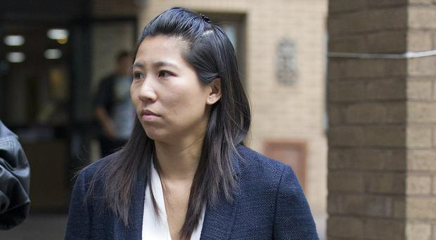 Julie Wong leaves Southwark Crown Court in London after giving evidence in the trial of Kuntal Patel who denies trying to murder her mother