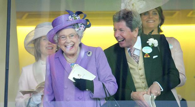 The Queen celebrating Estimate's Gold Cup win last year