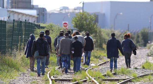 A group of migrants make their way through Calais