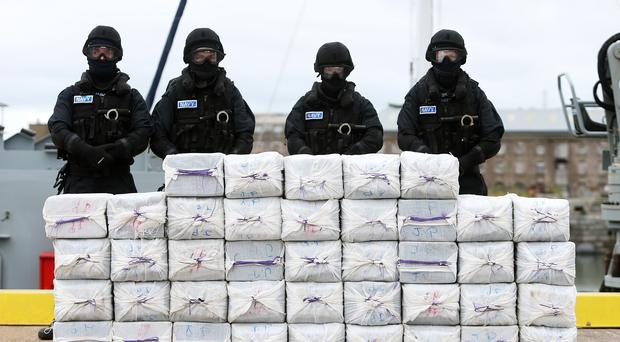 Members of the navy stand behind cocaine which was taken from on board the yacht Makayabella in Co Cork