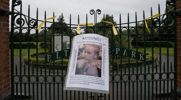A sign for missing teenager Alice Gross tied to the railings of Elthorne Park