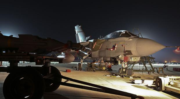 An RAF Tornado GR4 at RAF Akrotiri Cyprus being armed ahead of combat missions against Islamic State militants in northern Iraq.
