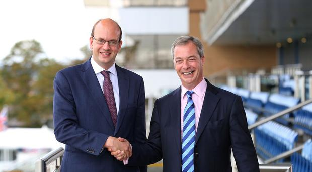 Ukip leader Nigel Farage welcomes Mark Reckless to the Ukip annual conference at Doncaster racecourse in South Yorkshire