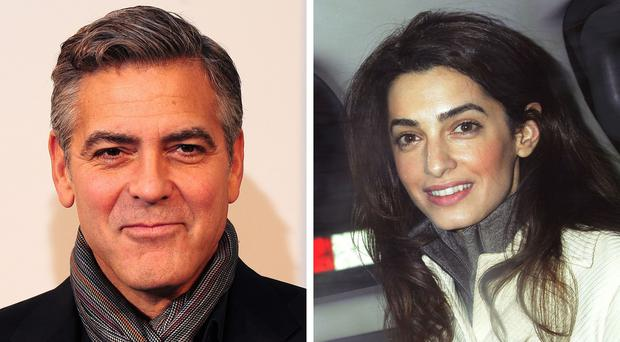 Crowds cheered George Clooney and his wife Amal Alamuddin