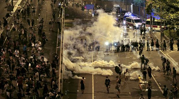 Riot police fire tear gas at student protesters occupying streets in Hong Kong (AP)