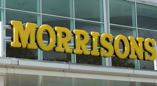 The City regulator said a former executive at Morrisons has been charged with two offences of insider dealing