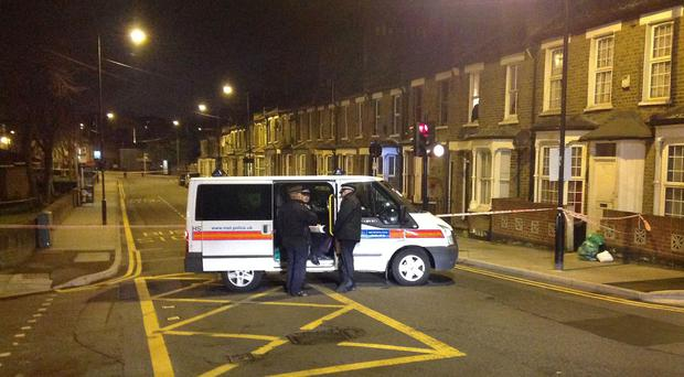 Police at the scene in Hackney, east London, where Shereka Fab-Ann Marsh, 15, was shot dead