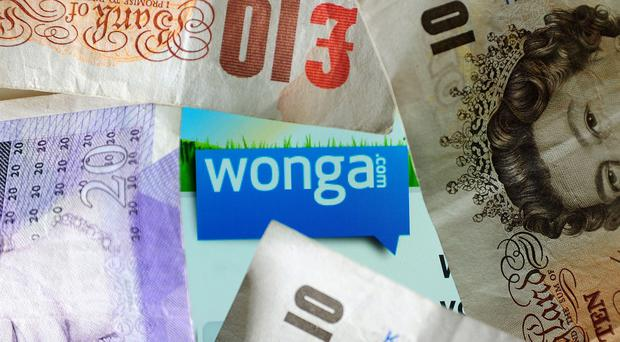 Wonga has been attacked by MPs for charging interest rates of over 5,000%