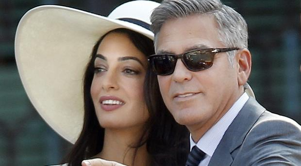 George Clooney and Amal Alamuddin in Venice. (AP)