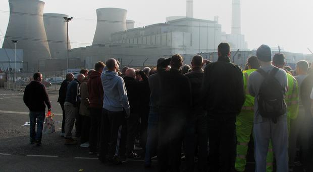 Workers at a new power station in Ferrybridge, West Yorkshire, after they walked out on unofficial strike in a row over toilets.