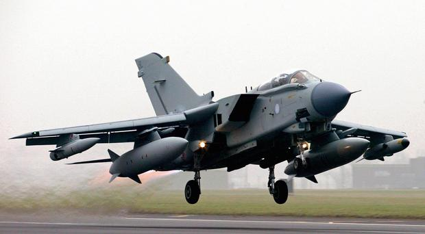 Philip Hammond defended the RAF's cautious approach to military operations in Iraq