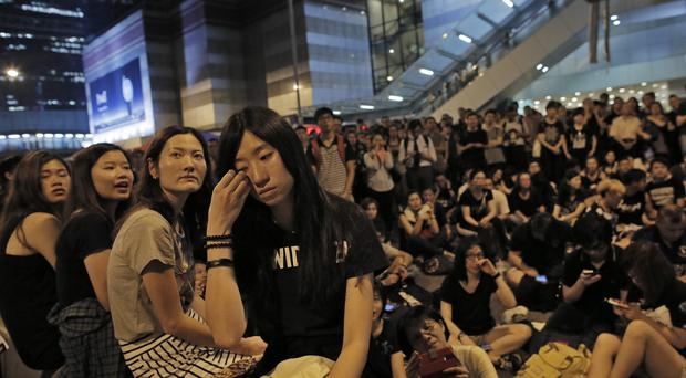 The UK Government has been urged to act as Hong Kong democracy campaigners continue their protests