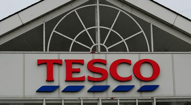 Tesco will post its first yearly figures since Mr Lewis was drafted in to turn around its fortunes following a series of profit warnings amid a ferocious price war with rivals