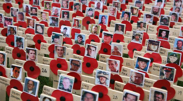 Faces on crosses of some of Britain's armed forces who have died in Afghanistan.