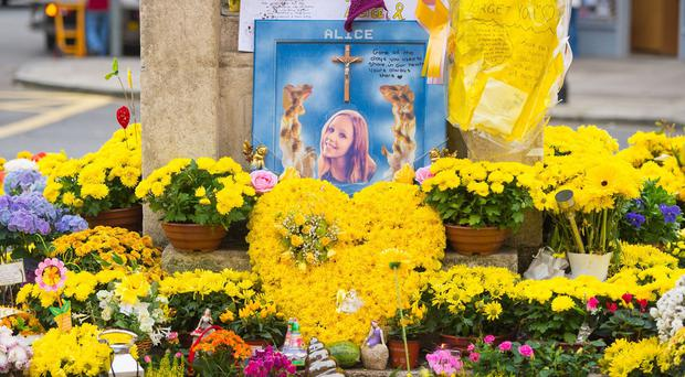 Tributes in memory of murdered teenager Alice Gross at Hanwell Clock Tower