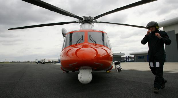 A helicopter was deployed in the Coastguard operation to find a missing trawler crew