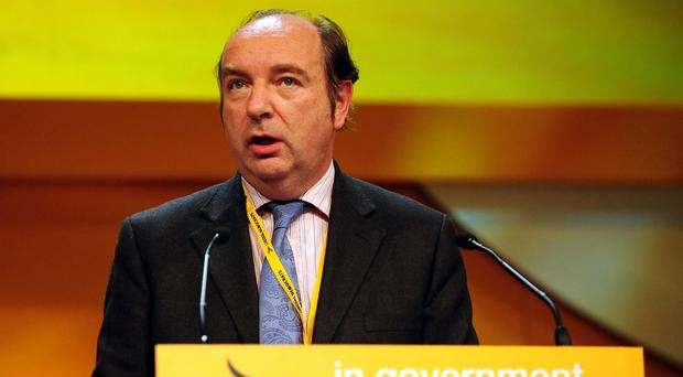 Norman Baker said working with Home Secretary Theresa May had been like walking through mud