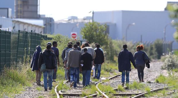 Migrants in Calais wait for a chance to reach the UK