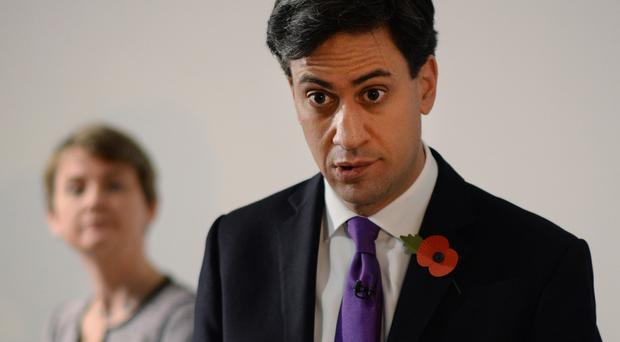 Shadow home secretary Yvette Cooper, pictured with Ed Miliband, has denied making a secret pact with Andy Burnham in the event of the Labour leader quitting