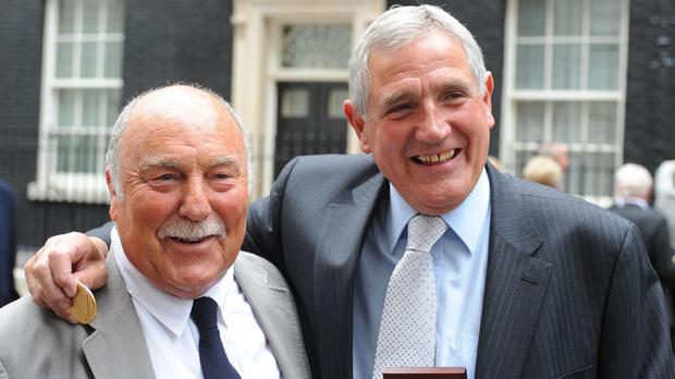 Jimmy Greaves (left) and Norman Hunter collecting medals at Downing Street in 2009