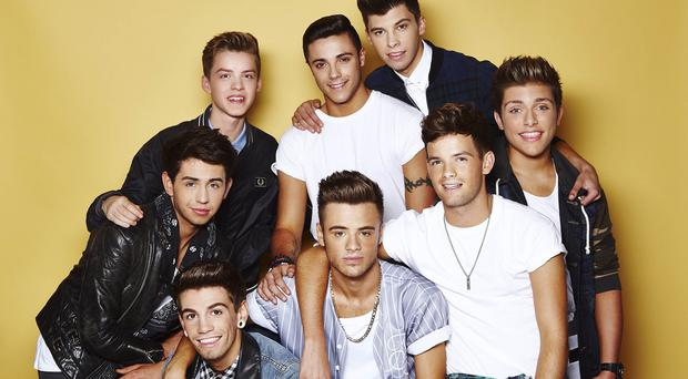 Boyband Stereo Kicks had a stage invader during their performance on The X Factor (Picture: SYCO/THAMES TV)