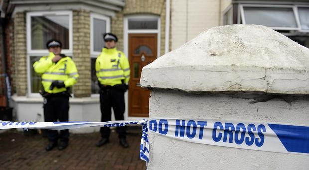 Police officers outside a house in Desborough Avenue, High Wycombe after four men were arrested in connection with an alleged Islamist terror plot.