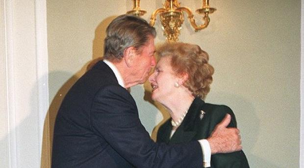 Ronald Reagan greets Margaret Thatcher in London