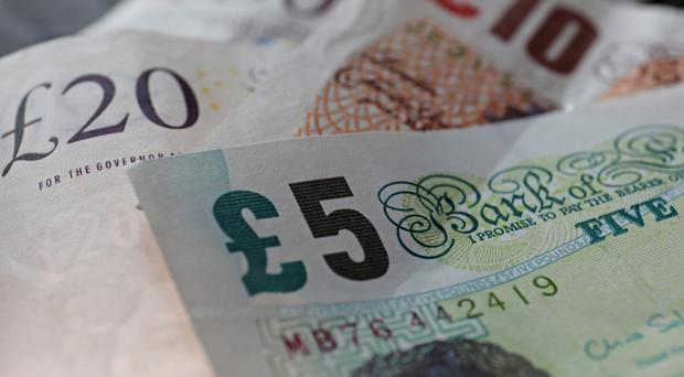 A cap on the fees and interest charged by payday lending firms will go ahead in January
