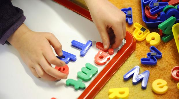 The Government's scheme to offer free care for young children is in 'crisis', it has been claimed