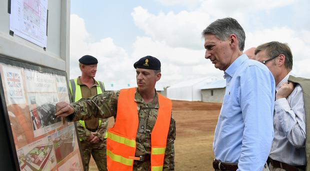 Philip Hammond says legislation on foreign aid is not needed as a United Nations target is being met.