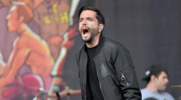 A Day To Remember cut short a show after a fan was badly hurt in a fall from a balcony