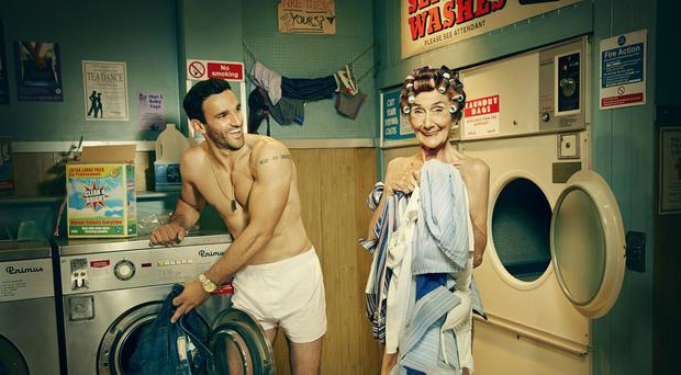 EastEnders stars Davood Ghadami (Kush Kazemi) and June Brown (Dot Branning) pose for a new calendar on sale for BBC Children In Need (BBC/PA)