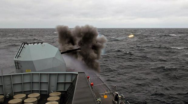 The Royal Navy frigate HMS Iron Duke during high-explosive training in San Carlos Water and Falkland Sound