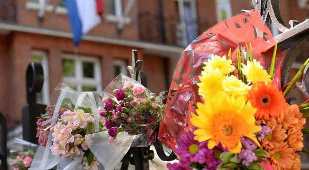 Flowers left outside the Dutch Embassy in London in memory of those who died on Malaysia Airlines flight MH17