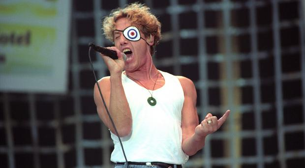 The Who's Roger Daltrey, complete with white eye patch, performing when the band played Hyde Park in 1996