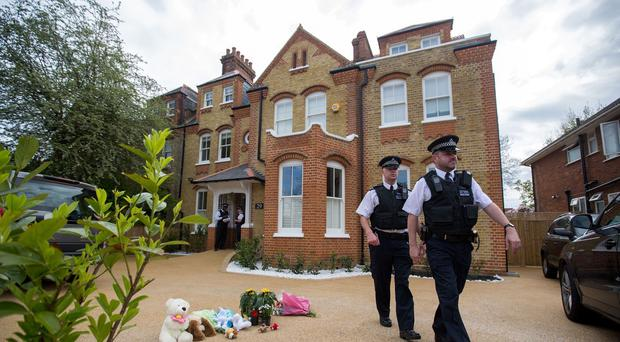 Police at the scene of the house where Tania Clarence killed three of her children