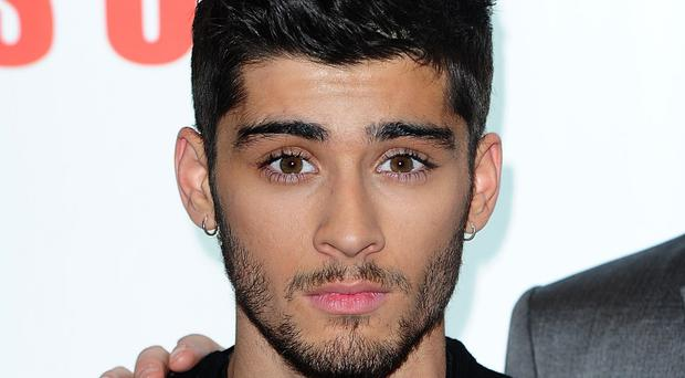 One Direction star Zayn Malik said a stomach bug made him miss a US TV interview