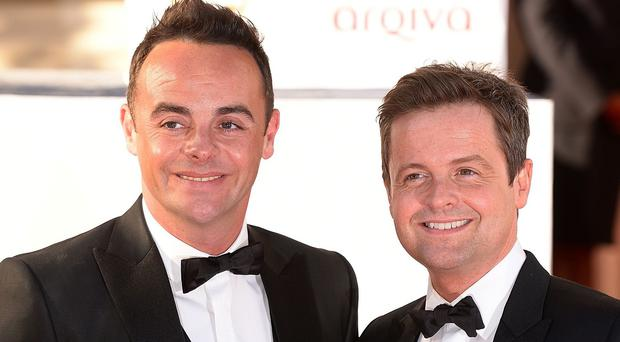 Ant McPartlin, left, has revealed that showbiz partner Declan Donnelly never told him he was going to propose to his girlfriend