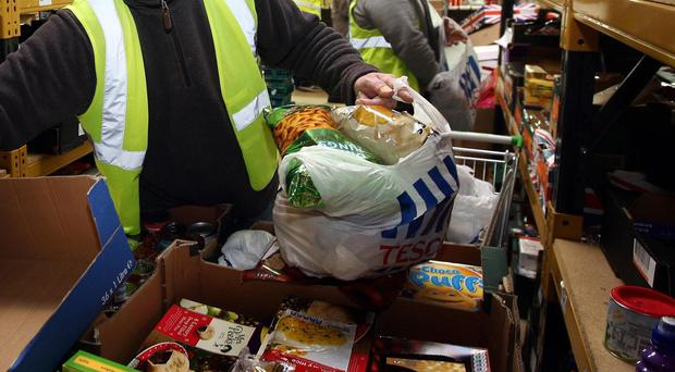 Problems linked with benefits often trigger visits to food banks, according to a report by Oxfam, Child Poverty Action Group, the Church of England and the Trussell Trust